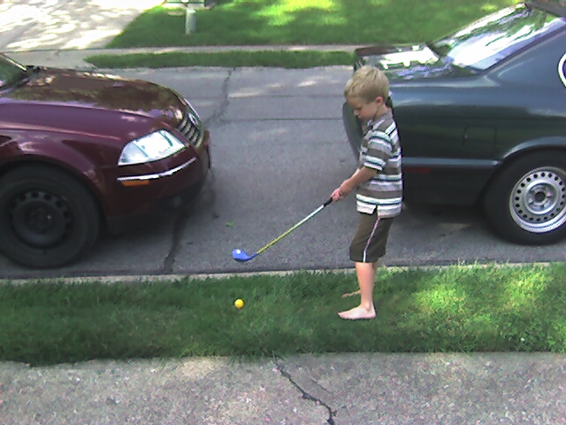 Jack Practices Golf in the Front Yard