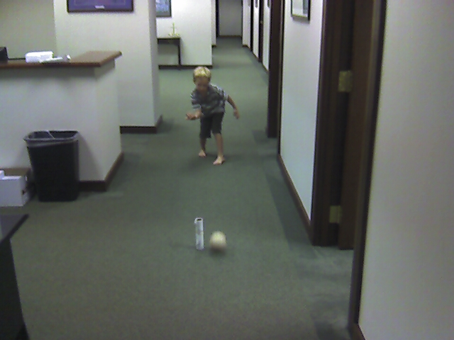 Jack is Bowling With a Rubber Band Ball He Found By the Copier